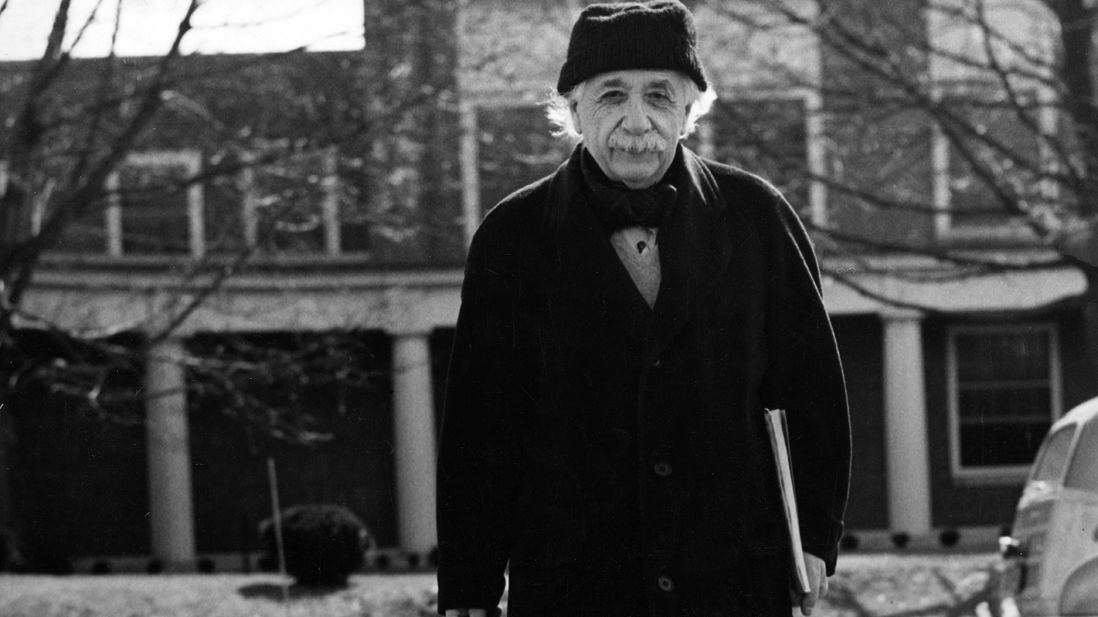 SPECIAL PRICE. Albert Einstein leaves Fuld Hall, Princeton, New Jersey, USA circa 1940s/50s